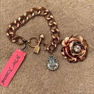 Betsy Johnson rose gold tone bracelet with charms